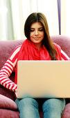 Happy woman using laptop — Stock Photo