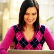 Smiling woman using laptop — Stock Photo