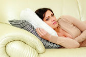 Woman lying on the sofa at home — Stock Photo