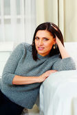 Middle-aged thoughtful woman at home — Stockfoto
