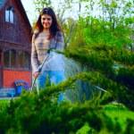 Beautiful woman in garden — Stock Photo #45275199