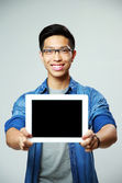 Young handsome asian man in glasses — Stock Photo