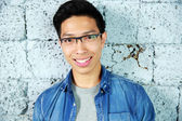 Young handsome asian man in glasses — Stockfoto