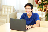 Handsome asian man at home — Stok fotoğraf
