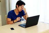 Handsome asian man at home — Stock Photo