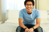 Handsome asian man at home — Stock fotografie