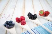 Fresh berrys fruit on wooden spoon — Stock Photo