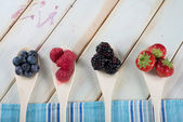 Fresh berrys fruit on wooden spoon — Stock Photo