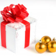 Gift box and Christmas balls - Stock Photo