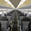 Interior of the passenger airplane - Stock Photo