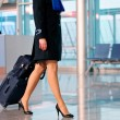Woman with bag at airport  — Foto Stock