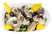 Boiled fish with olives and lemon — Stock Photo