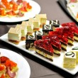 Stock Photo: Party table with cakes and canapes