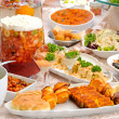 Table with variety of food — Stock Photo