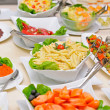 Colorful fresh salads on the table — Stockfoto