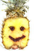 Smiling pineapple — Stock Photo