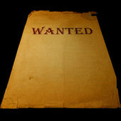 Old western wanted sign isolated on black background — Photo