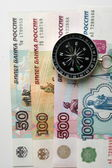 Compass on the background of banknotes — Stock Photo