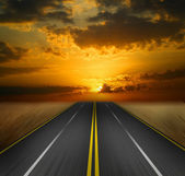 The road into the sunset — Stock Photo