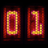 The  Nixie tube indicator of the numbers of retro style. Indicator glow with a magical purple fringing. Digit 0, 1 — Stock Photo