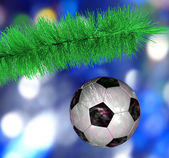 Soccer ball hanging on the Christmas tree branch — Stock Photo