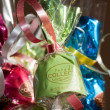 Stock Photo: Coloured sweets in gift wrapping with ribbons