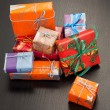 Royalty-Free Stock Photo: Colourful gift boxes of different sizes, black background