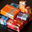 Colourful gift boxes, black background — Foto Stock