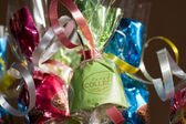 Coloured sweets in gift wrapping with ribbons — Stock Photo