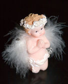 Little Angel on black background — Stock Photo