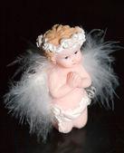 Little Angel on black background — Stock Photo