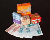 Gift boxes and money — Stock Photo