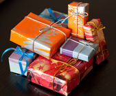 Colourful gift boxes, black background — Stock Photo