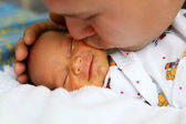 Father kissing baby — Stock Photo