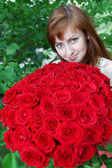 Beautiful woman with roses — Stock Photo