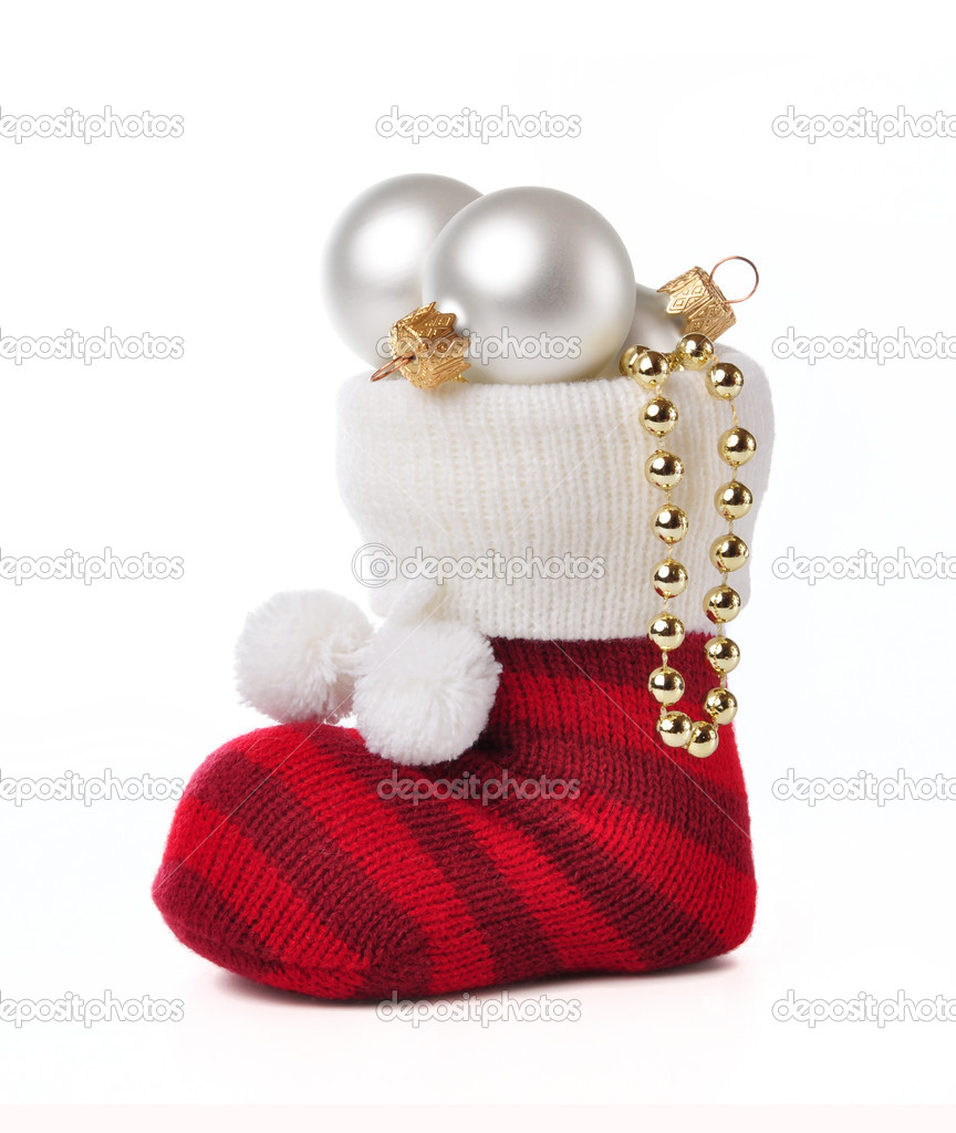 Sock with Christmas toys on a white background. — Lizenzfreies Foto #16883679