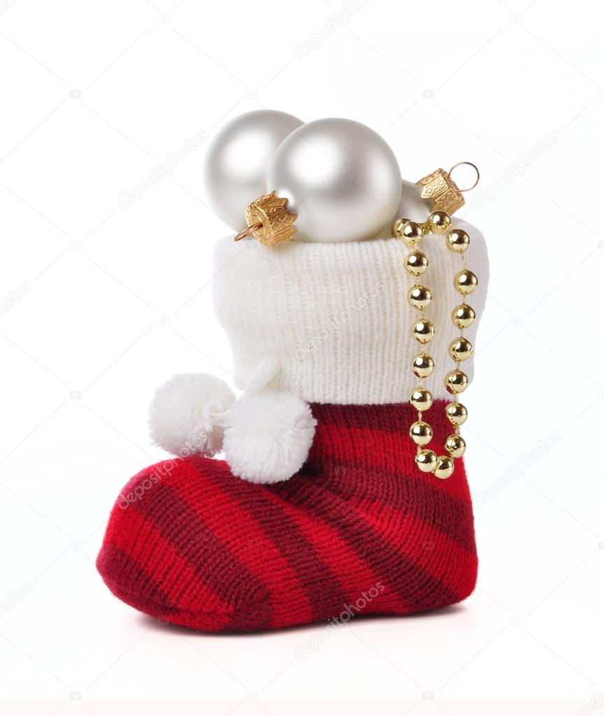 Sock with Christmas toys on a white background. — Stock fotografie #16883679