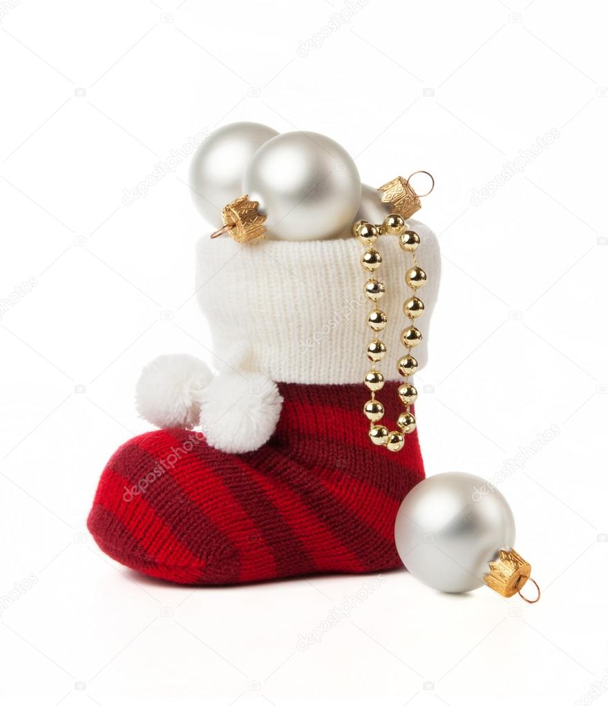 Sock with Christmas toys on a white background. — Stockfoto #16883683