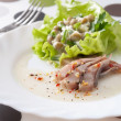 Stock Photo: Herring with lettuce.
