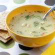 Stock Photo: Cream- soup with crackers.