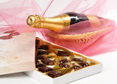 Chocolates and champagne. — Stock Photo