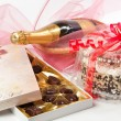 Chocolates, champagne  and cake. - Stock Photo