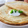 Stock Photo: Pancakes with sour cream.