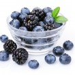 Glass of delicious blueberries and blackberries. — Stock Photo #16343223