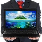 Businessman holding an open laptop — Stock Photo #19777561