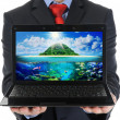 Businessman holding an open laptop — Stock Photo