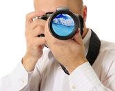 Man holds a camera — Stock Photo