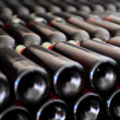 Old bottles of red wine - Stock Photo