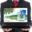 Businessman holding an open laptop — ストック写真
