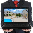 Businessman holding an open laptop — Foto de Stock